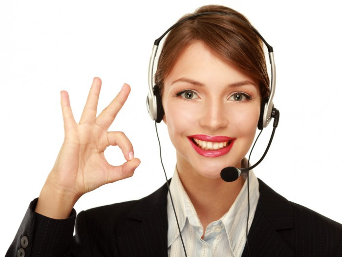 Customer-service-woman-on-headset-gives-OK-1024x770