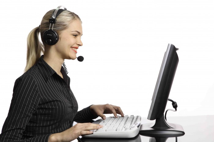 Technology-Woman-with-headset-at-computer-small