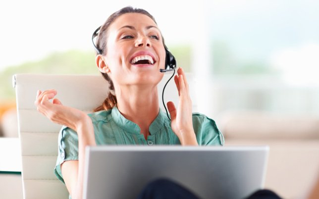 xwoman-laughing-headset.jpg.pagespeed.ic_.QXHksklRLc